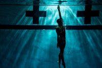 Swimmer reaching for light